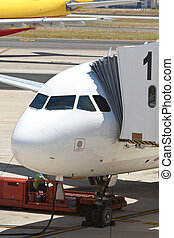 Airplane at an Airport With Passenger Gangway In Position