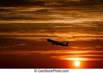Airplane at sunset sky on sun in the air with space for text. Silhouette of flying aircraft in sunlight. transportation concept. plane taking off in the dramatic sky. amazing atmospheric image