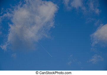 airplane at the sky with clouds