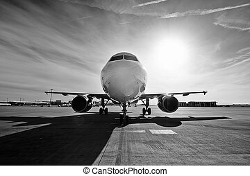 Airplane at the sunrise - Airplane is taxiing to take off at...
