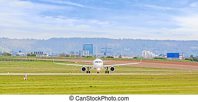 Airplane before takeoff on runway at airport
