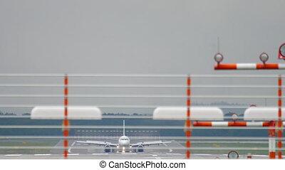 Airplane braking after landing at wet weather