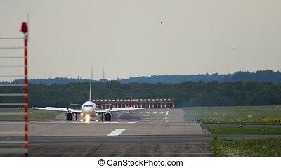 Airplane braking after landing. Dusseldorf Airport, Germany