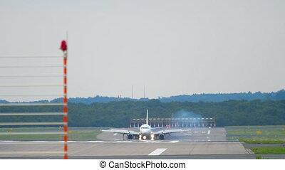 Airplane braking after landing in Dusseldorf Airport
