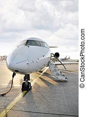 Passenger airplane charging in airport
