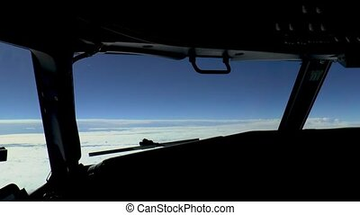 Airplane cockpit, pilot view while experiencing light turbulence.