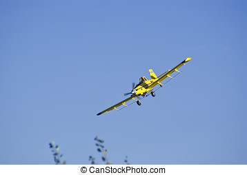Airplane coming in close for a run at the cornfield.