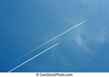 Airplane contrails on blue sky.