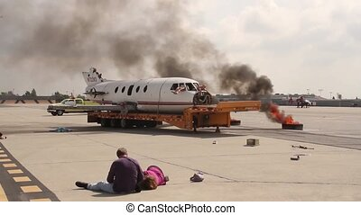 Airplane crash reenactment with damaged plane and fire