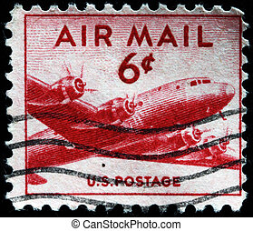 airplane DC-4 - UNITED STATES - CIRCA 1946: stamp printed by...