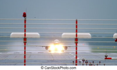 Airplane departure at rain from Dusseldorf airport, Germany
