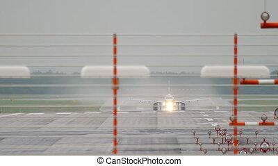 Airplane departure at rainy weather - DUSSELDORF, GERMANY -...