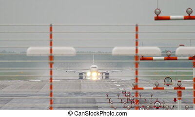Airplane departure at rainy weather - DUSSELDORF, GERMANY -...
