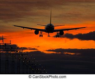 Airplane - Big jet plane landing on runway in evening