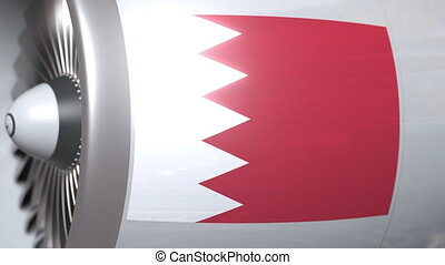 Airplane engine with flag of Bahrain. Bahraini air...