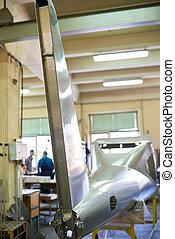 Airplane fin, workshop.
