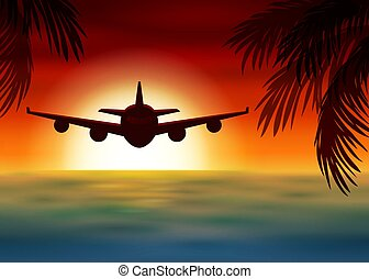 Airplane flies over the sea at sunset