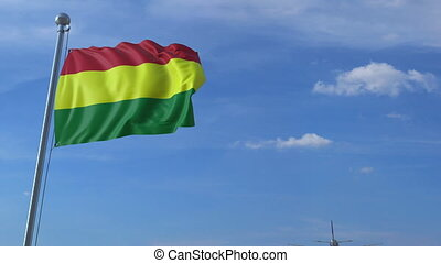 Airplane flies over waving flag of Bolivia. 3D animation
