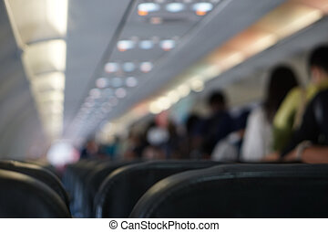 airplane flight from inside blurred seats background