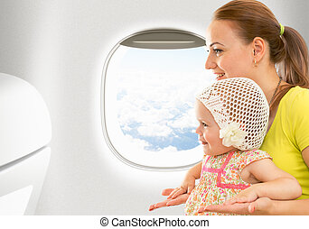 Airplane flight from inside. Woman and kid travelling...