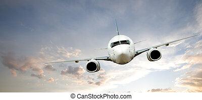 Airplane Flight - Airplane in Flight at Sundown
