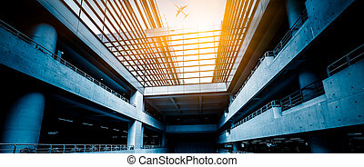 airplane fly above the airport building