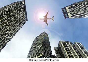 Airplane flying above office buildings