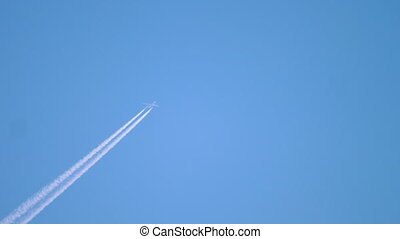 Airplane flying high in the sky