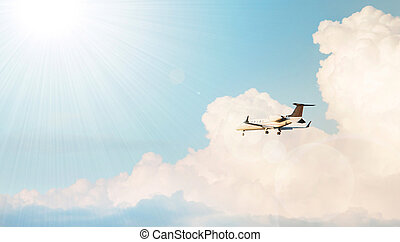 Airplane flying in a cloudy sky
