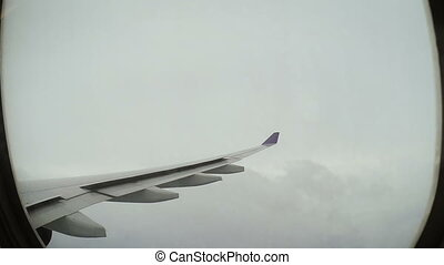 Airplane flying in stormy sky