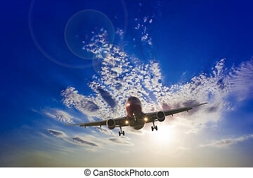 airplane flying in the blue sky with clouds. travel concept