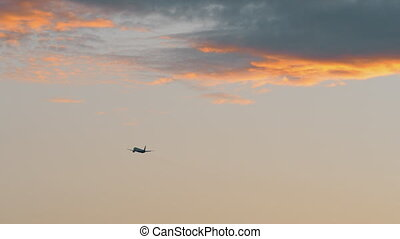 Airplane flying in the evening sky