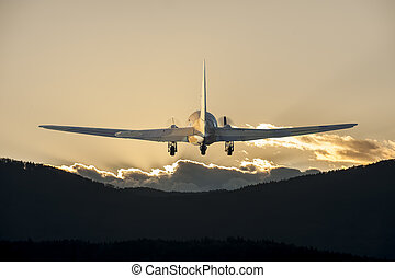 Airplane flying in the sunset time