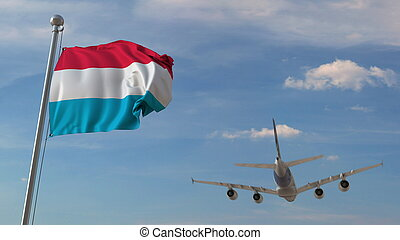 Airplane flying over flag of Luxembourg. Luxembourgian ...
