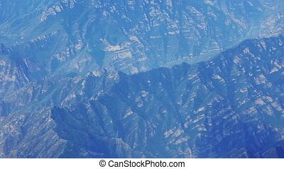 Airplane flying over mountains