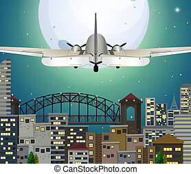 Airplane flying over urban city