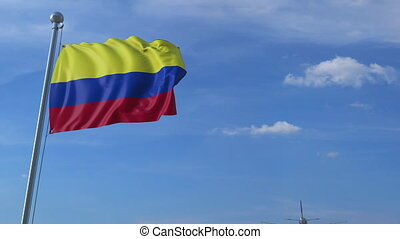 Airplane flying over waving flag of Colombia