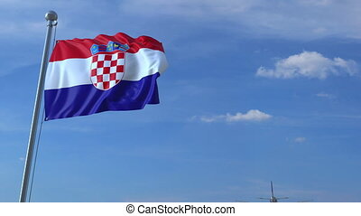Airplane flying over waving flag of Croatia