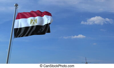 Airplane flying over waving flag of Egypt