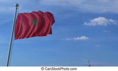 Airplane flying over waving flag of Morocco