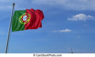 Airplane flying over waving flag of Portugal