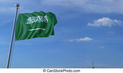 Airplane flying over waving flag of Saudi Arabia -...