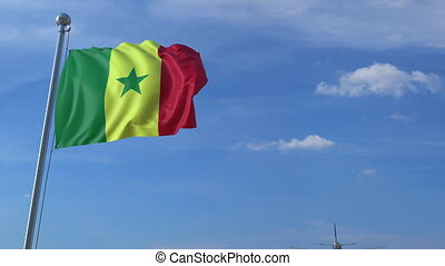 Airplane flying over waving flag of Senegal - Commercial...