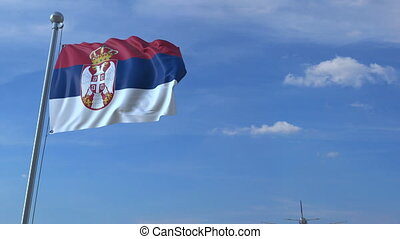 Airplane flying over waving flag of Serbia - Commercial...