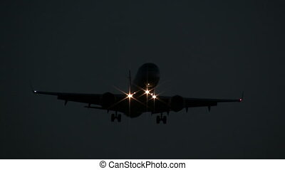 Airplane flying overhead at night