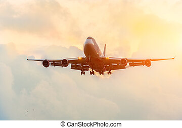 Airplane flying sunset orange sky abstract background