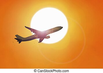 Airplane flying under sunset with yellow sky