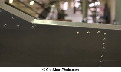 Airplane fuselage close up. Metal with rivets.