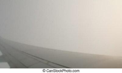Airplane going through clouds