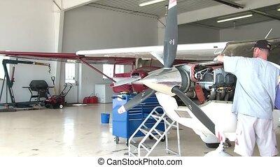 Airplane Hanger Mechanics Working